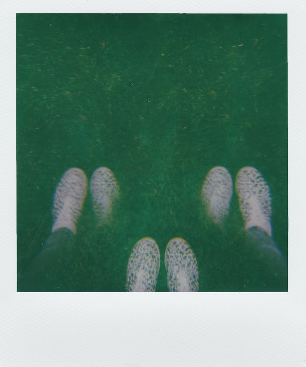 Instant Photography Of A Person's Footwear