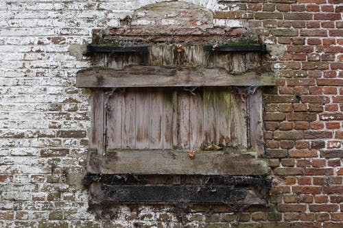 Free stock photo of brick wall, covered window, untenanted