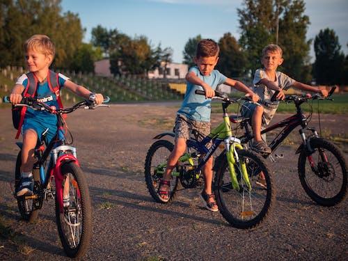 Three Boys Riding Their Bikes