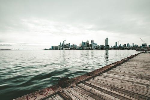 Photo of Pier Against City Buildings