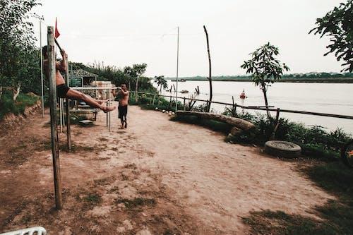 Gratis stockfoto met Aziatische mensen, bodybuilden, bomen, buiten
