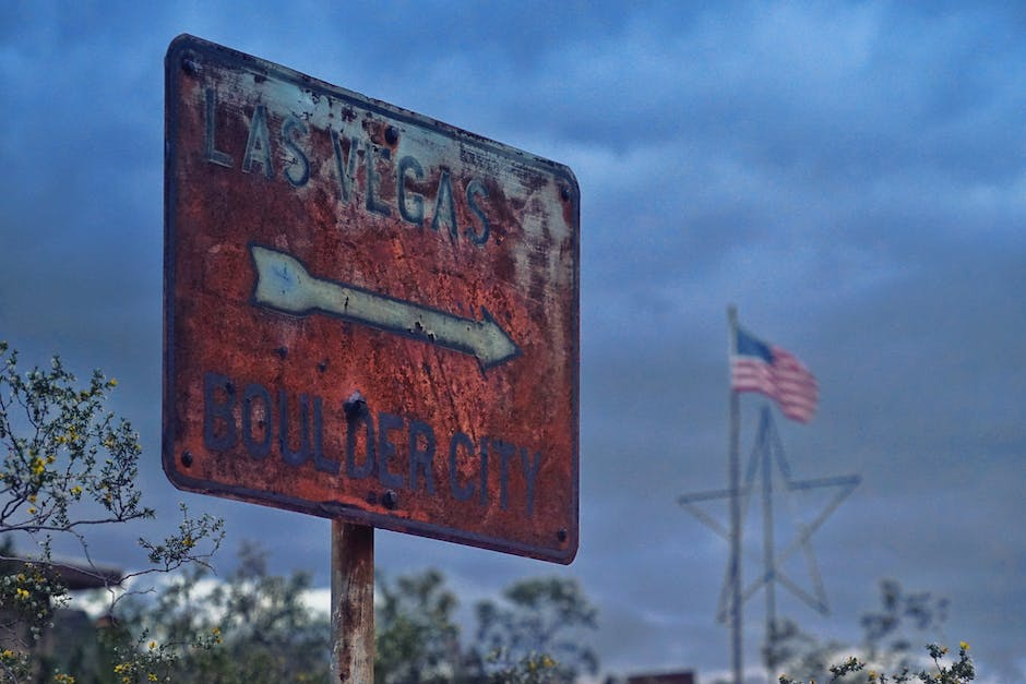 A old rusty red and white signage