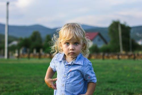 Cute Little Girl Wearing Blue Button-up Shirt