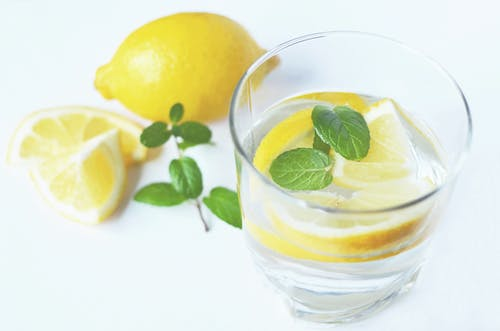 Clear Drinking Glass With Slice Lemon