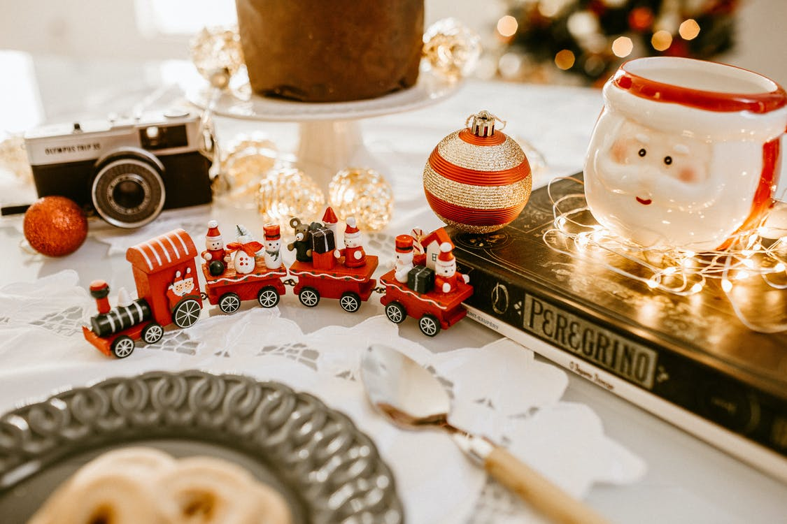 Red Train Toy Beside Christmas Decors
