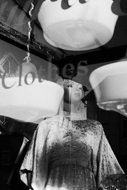 Mannequin Behind Glass Wall in Monochrome Photo
