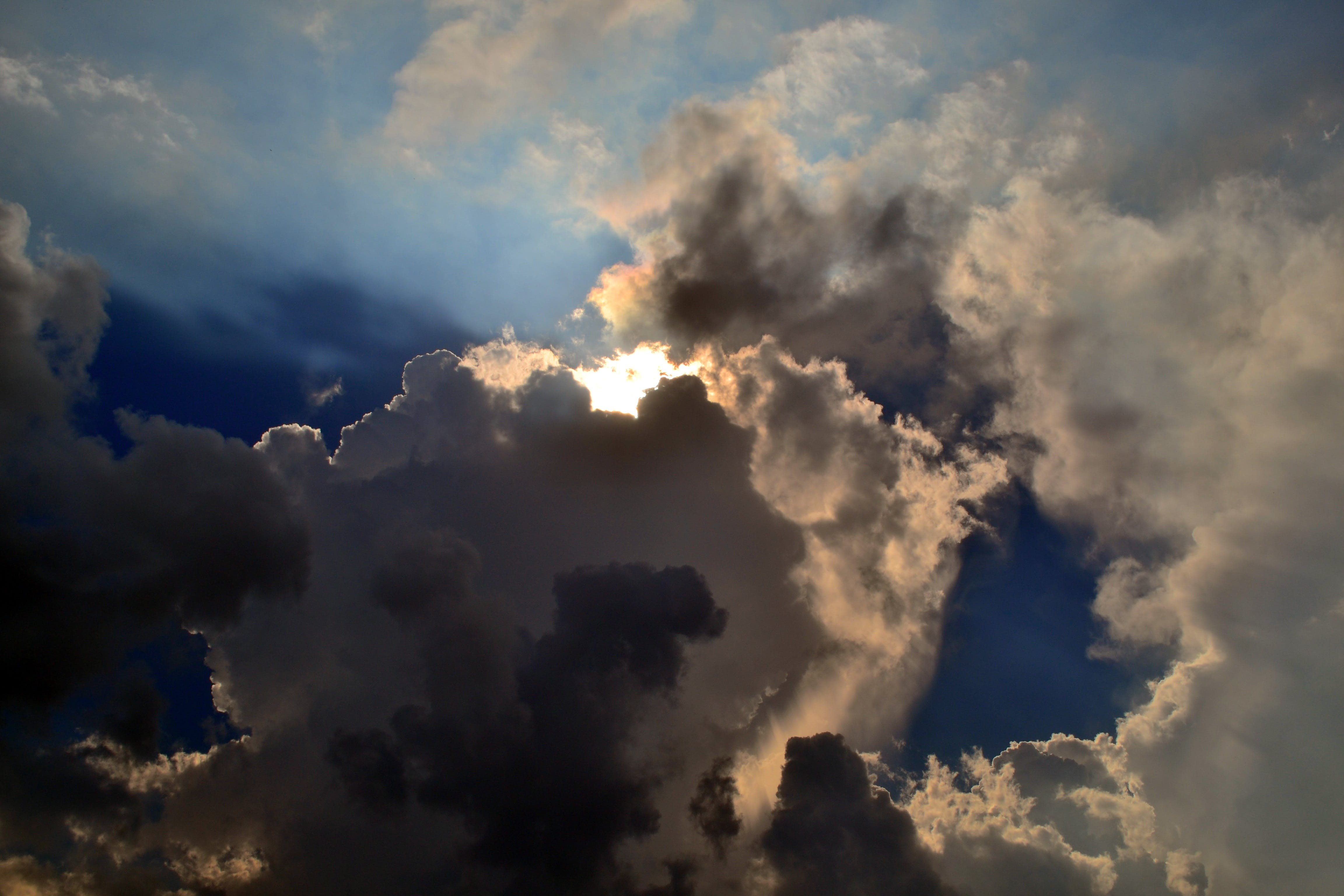 Gray Clouds Cover Sun Under Blue Sky