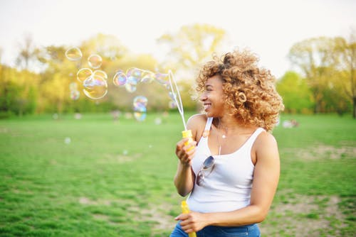 Woman Playing With Soap Bubble