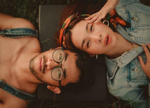Man Lying Down Beside Woman