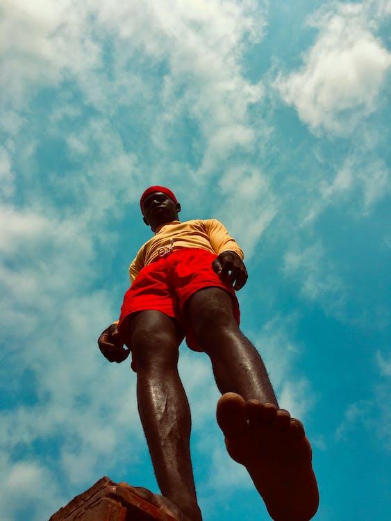 Man Wearing Red Shorts