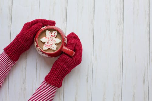 Person Wearing Red Gloves Holding Red and White Ceramic Mug