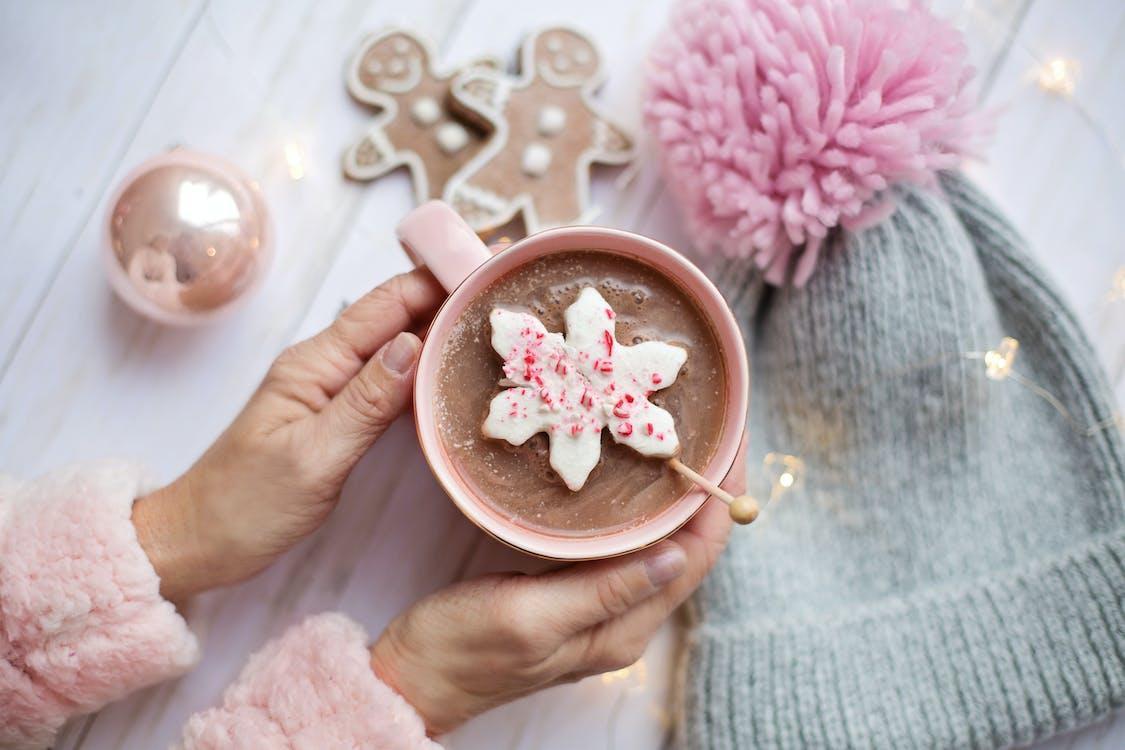Person Holding Mug of Hot Chocolate