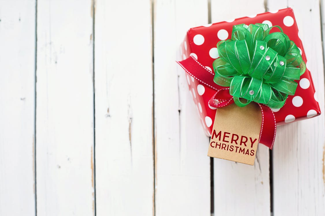 Minimalist Photography of a Red and Green Christmas Gift Box