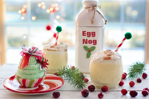 Egg Nog Bottle Near Cupcake, Red Berry Fruits, and Ice Cold Drinks