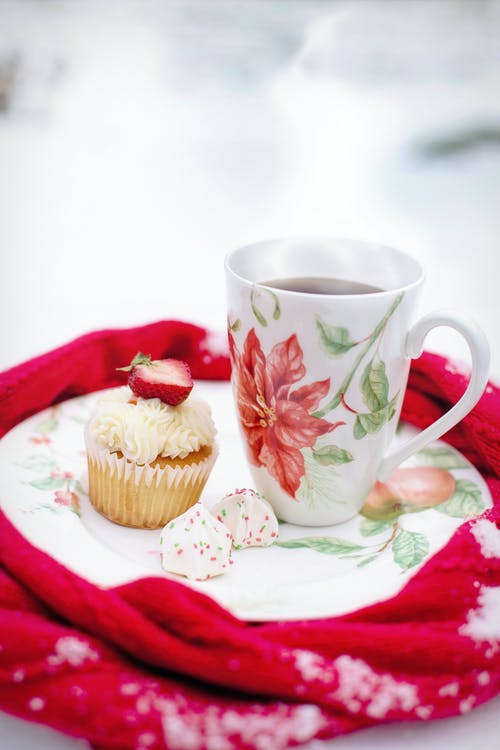 Beverage Filled Mug Beside Cupcake