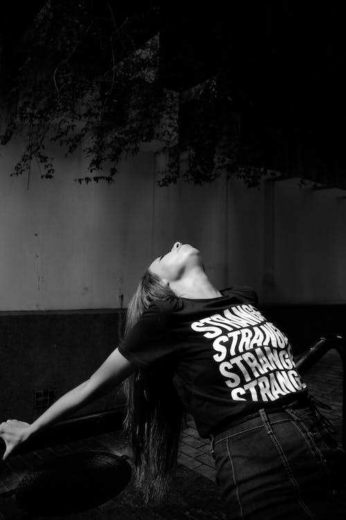 Monochrome Photo Of Woman Wearing Black Printed Shirt