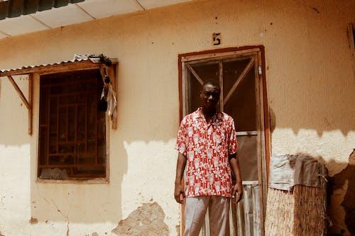 Photo Of Man Standing Beside Door