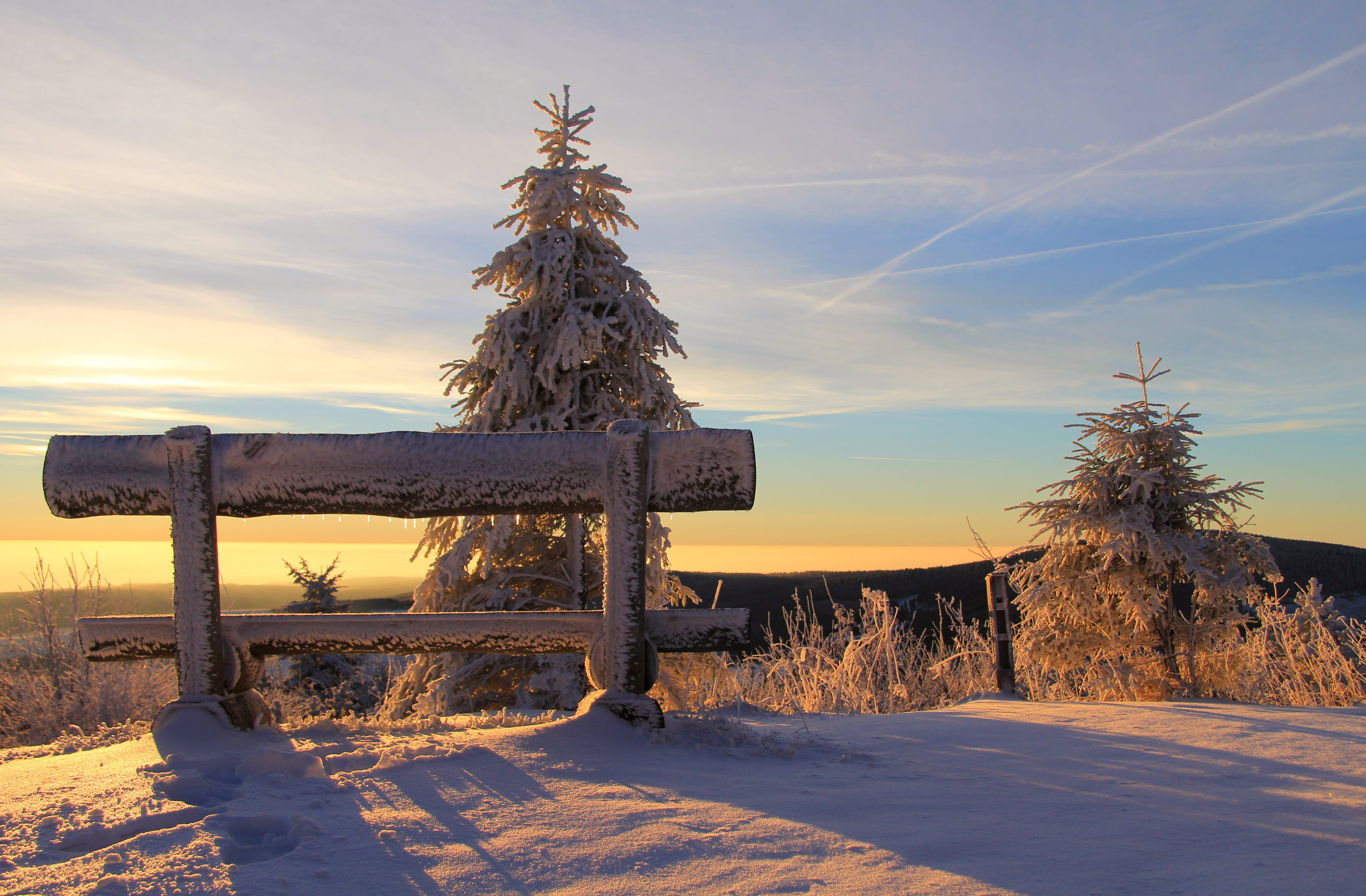 Snow Covered Bench on Mountain Top during Sunset
