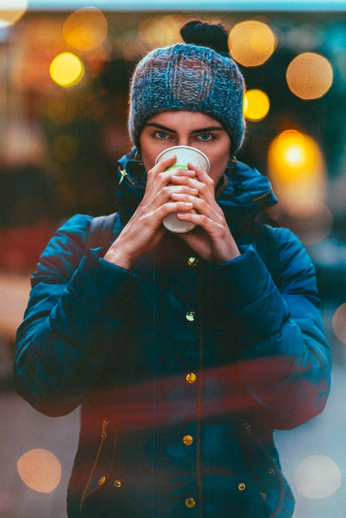 Photo Of Woman Holding White Cup