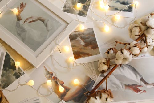 Photo Of String Lights On Top Of Pictures