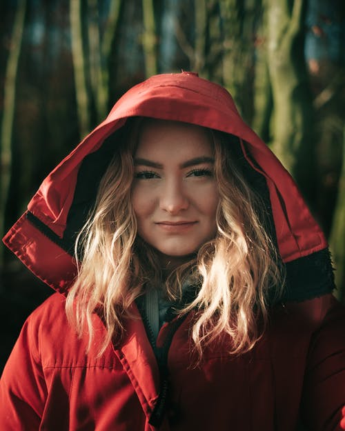 Photo Of Woman Wearing Red Jacket