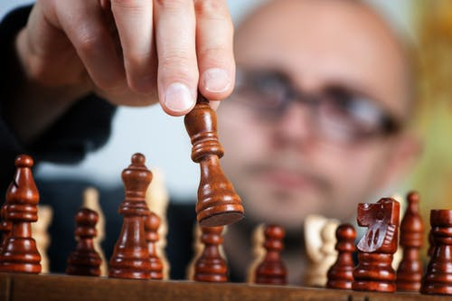 Shallow Focus Photography of Chess Pieces