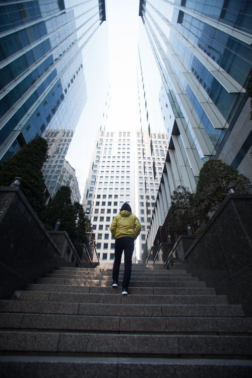 Low-angle Photography of a Person Walking Up a Stairs