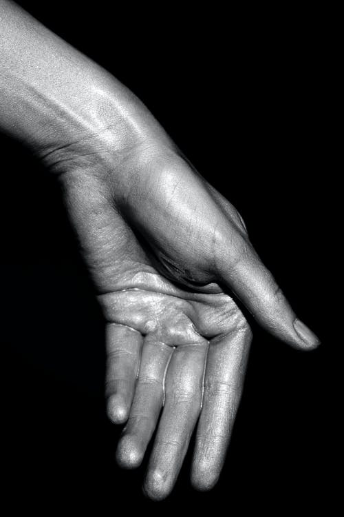 Human Hand With Silver Paint
