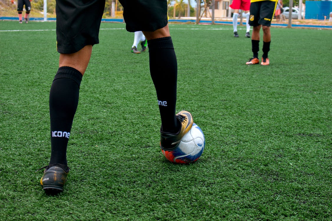 Person in Black and White Socks and Black and White Nike Soccer Ball
