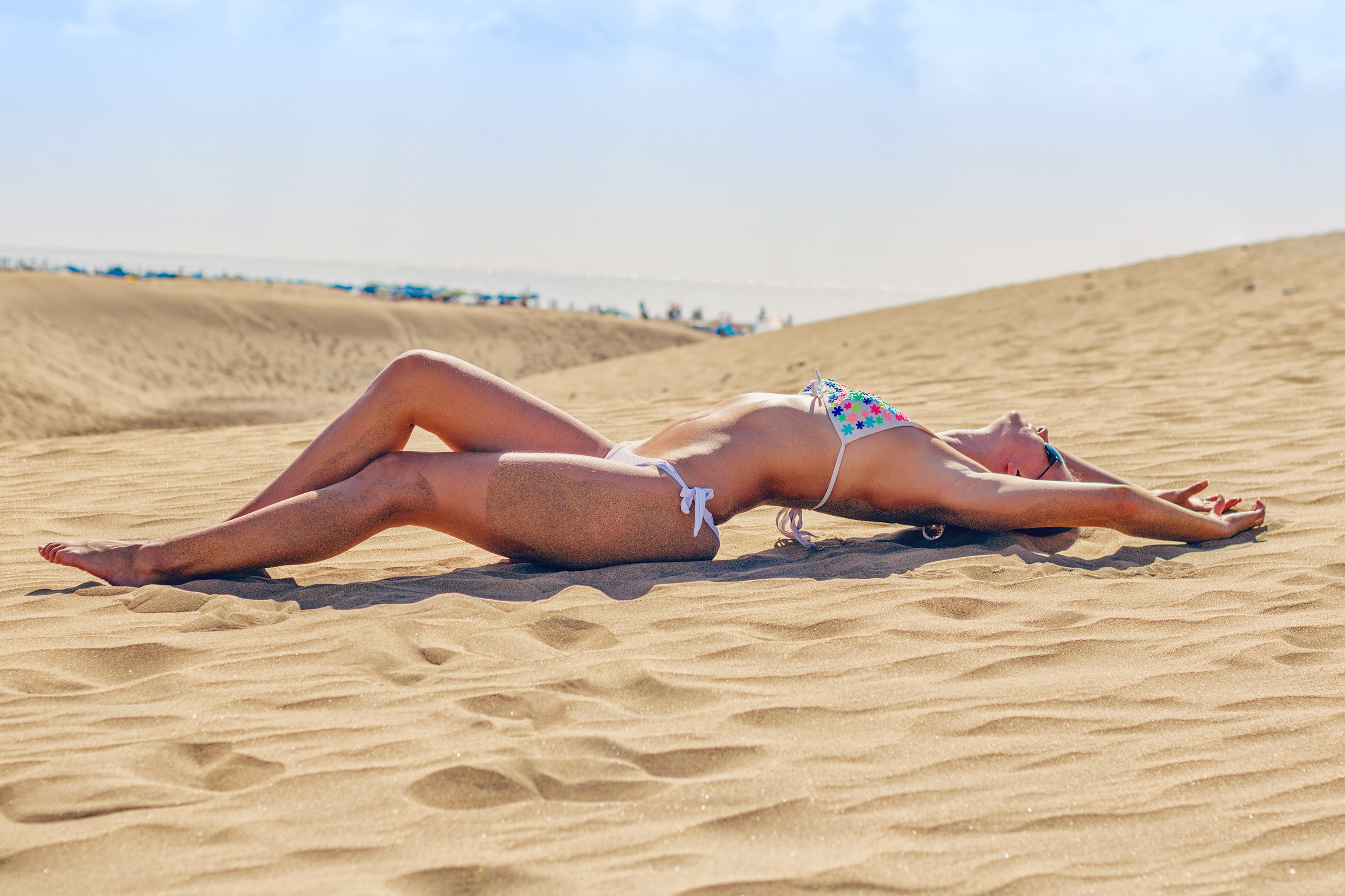 Woman Lying on Sand at Beach · Free Stock Photo