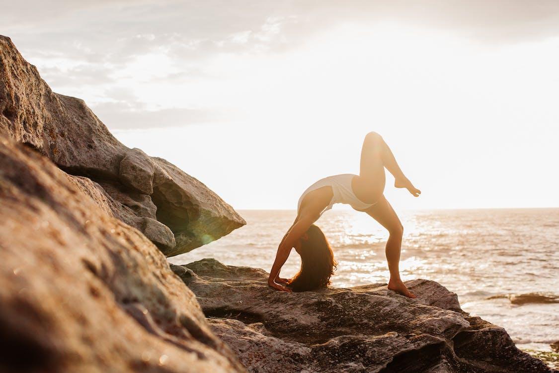 Woman Doing Yoga on Rock