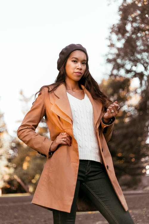 Woman Wearing Brown Coat and Black Denim Jeans