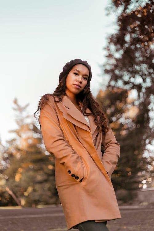 Woman Wearing Brown Coat
