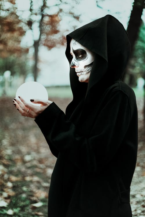 Photo Of Woman Holding Crystal Ball