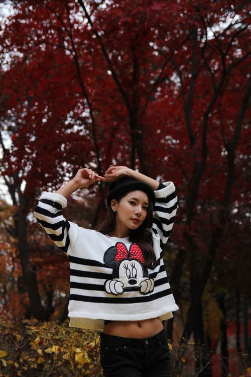 Photo Of Woman Wearing Mickey Mouse Sweater