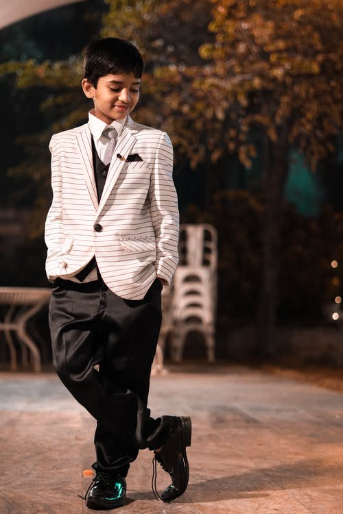 Shallow Focus Photo of Boy Wearing White Coat