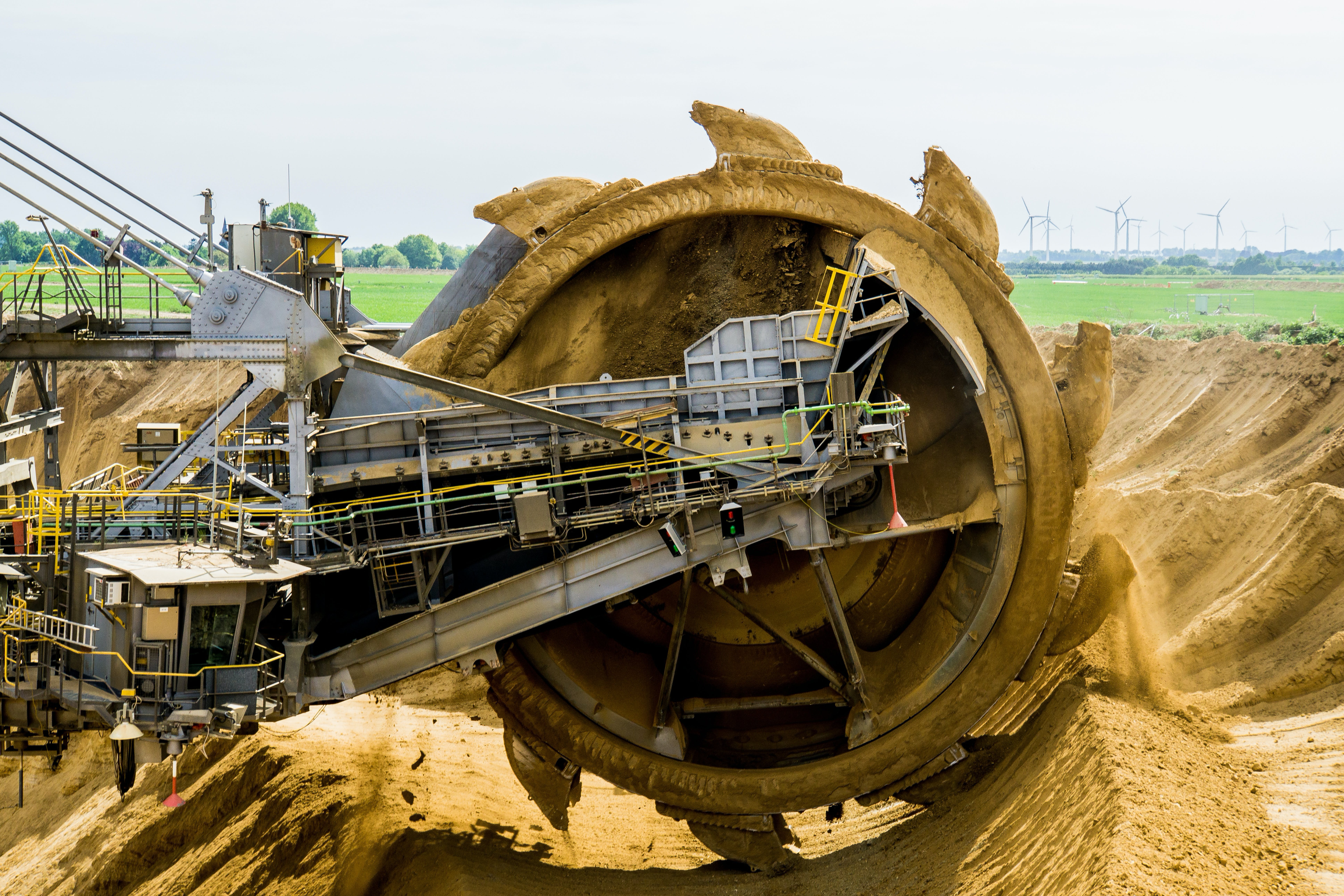 Round Brown and Grey Metal Heavy Equipment on Sand