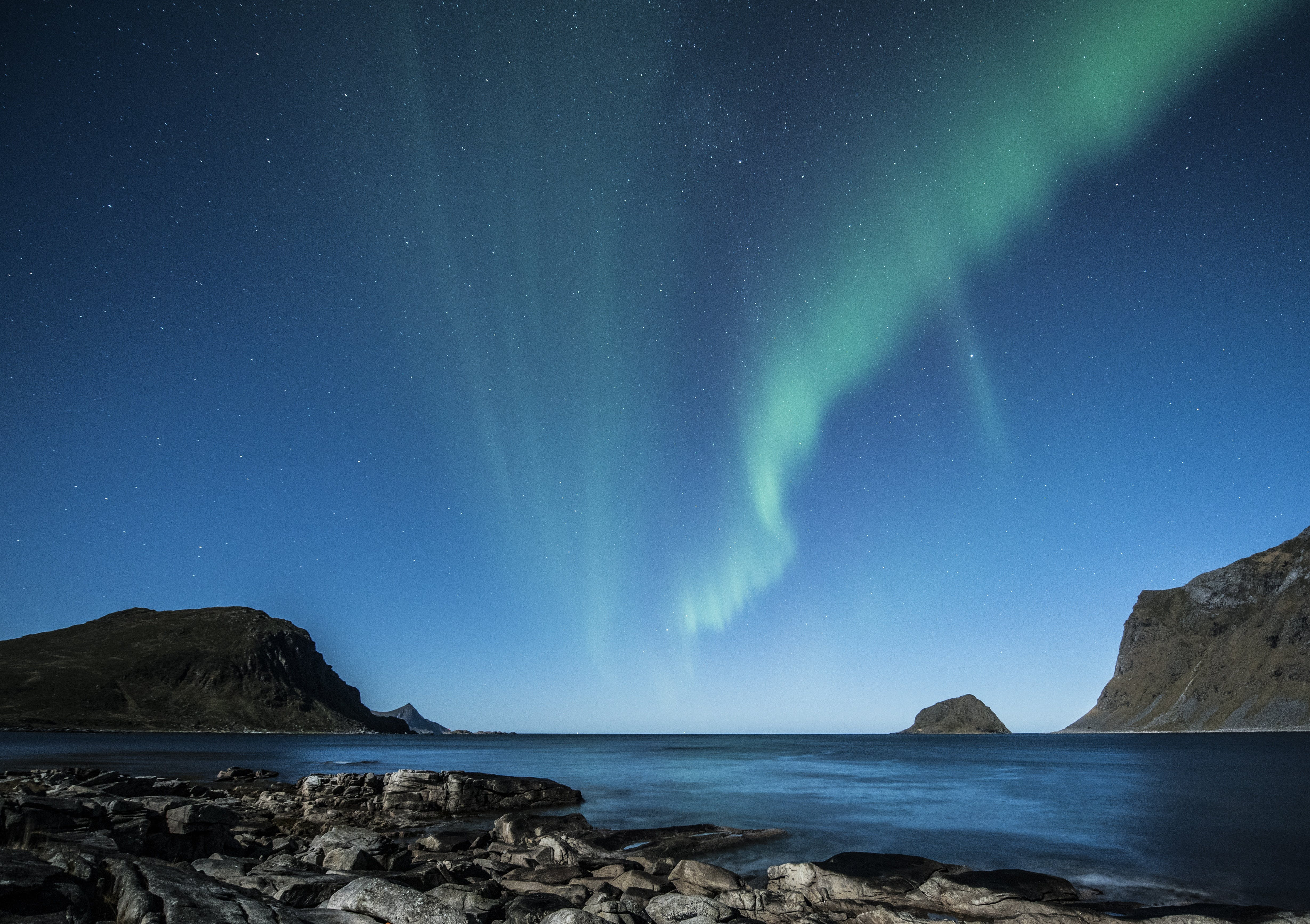 Green Aurora Lights Above Body of Water