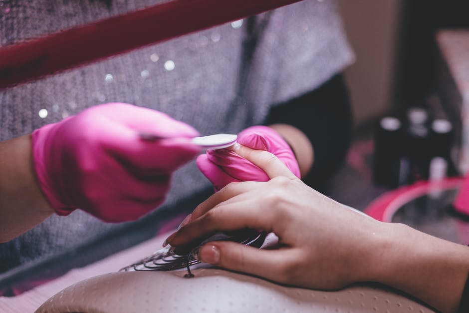 Close-up of Woman Having Manicure