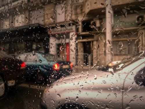 Бесплатное стоковое фото с боке, дорожное движение, капли дождя