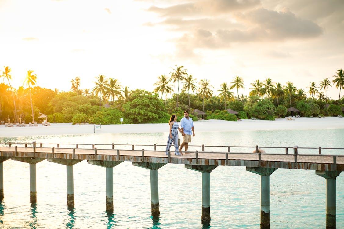 Photo Of People Walking On Wooden Footbridge