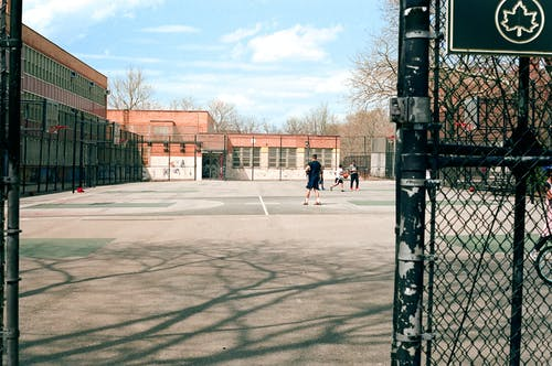People Playing on Basketball Court