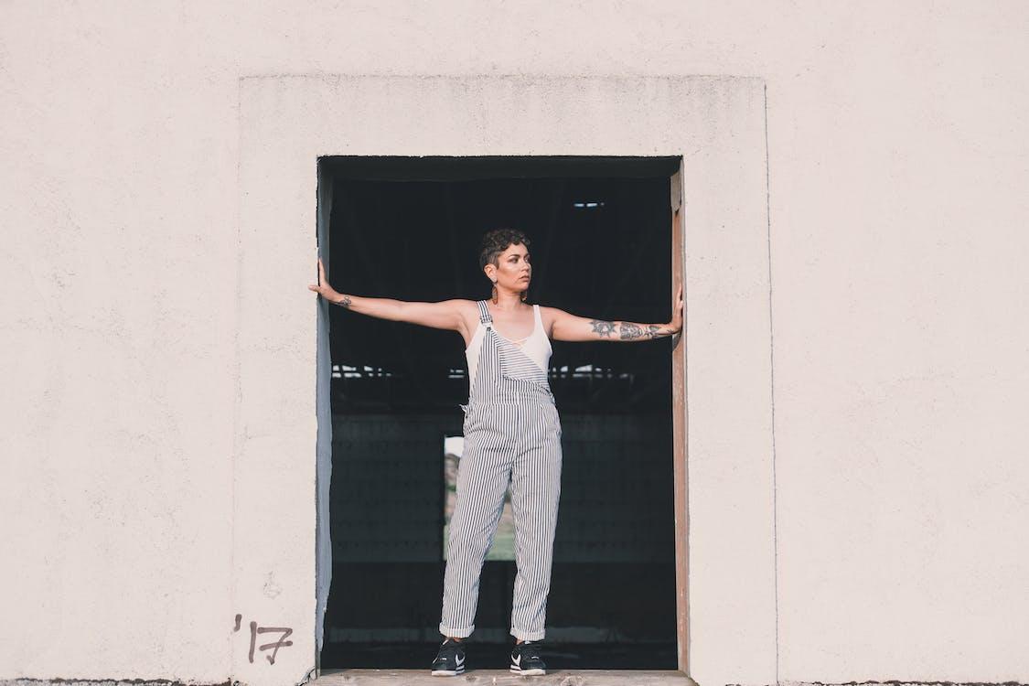 Photo Of Woman Standing On Door