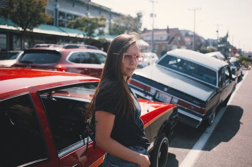 Photo Of Woman Standing Near Car