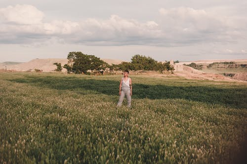 Woman Standing on Grass Field