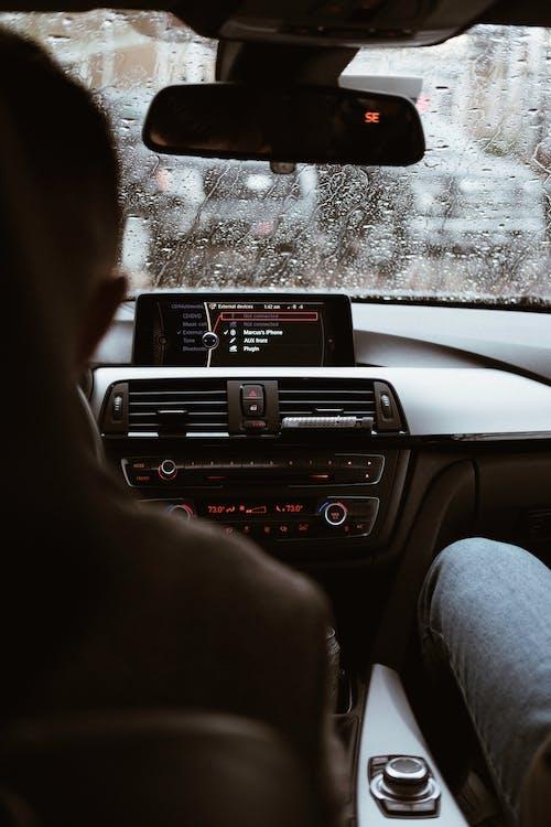 Photo Of People Sitting Inside Vehicle