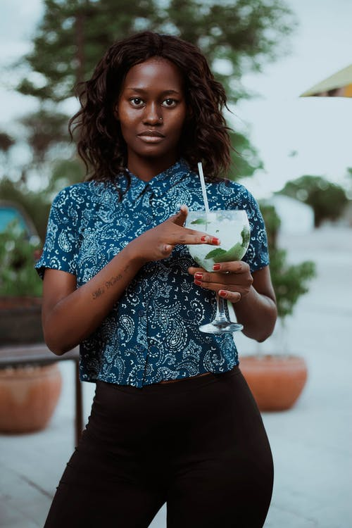 Shallow Focus Photo of Woman Holding Wine Glass