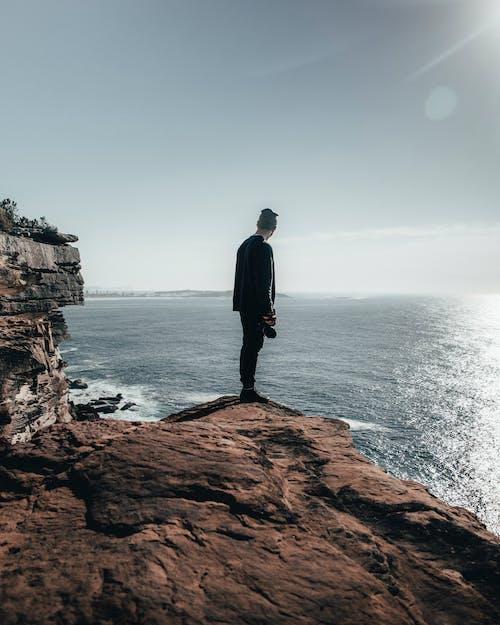 Безкоштовне стокове фото на тему «cliff edge, вид ззаду, горизонт, Денне світло»