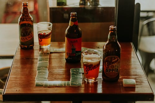 Photo Of Beer Bottles On Top Of Wooden Table