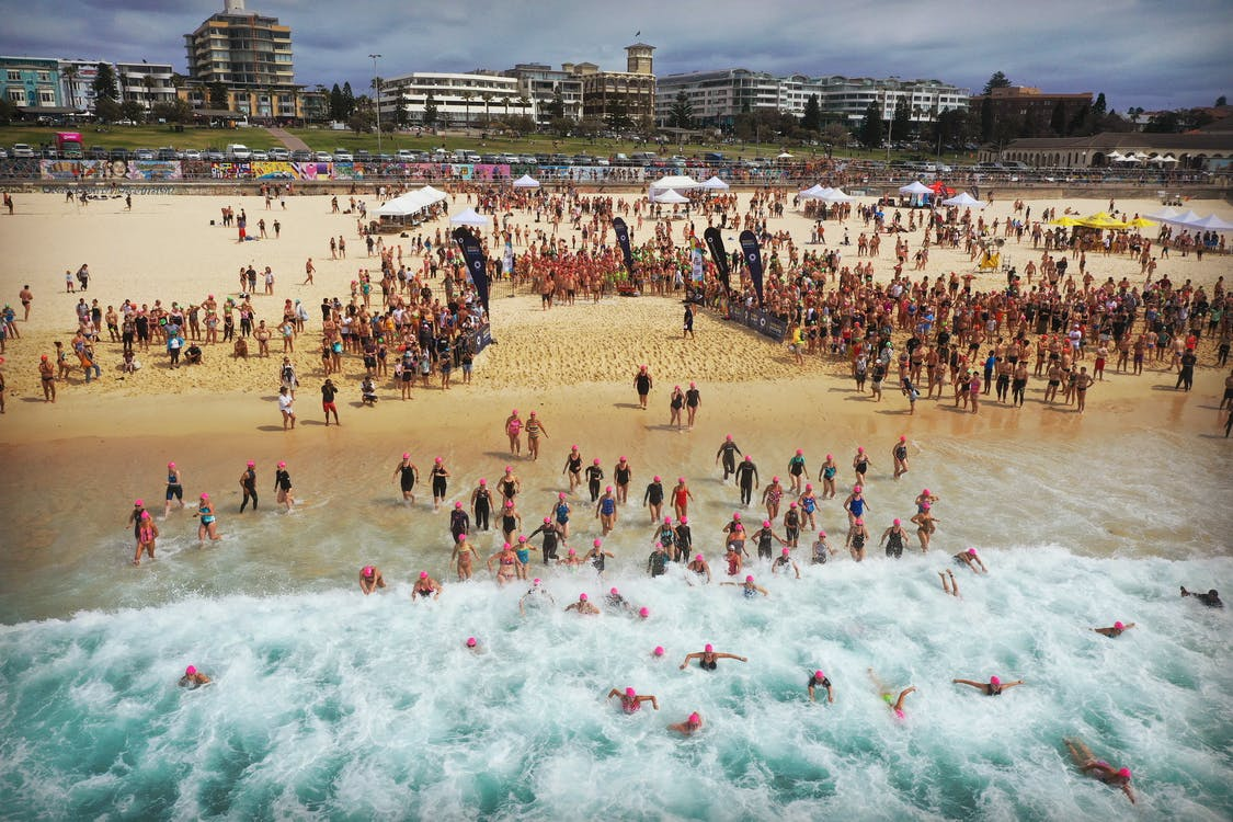 People Running in to the Water